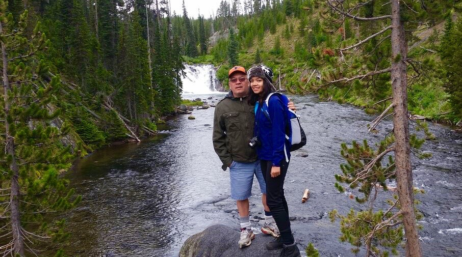 Trekker Crystal Savaria and her dad pause to enjoy the scenery during an afternoon hike.