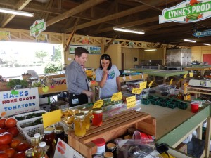 Tipton tours a revitalized farmers market with Ouachita Well Project Director Pamela Barton.