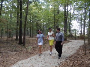 Tipton, Ouachita Well Project Director Pamela Barton and Ouachita Parish Police Juror Pat Moore walk a new walking trail behind Shady Grove Elementary School. The trail was made possible through Challenge Grant funding.