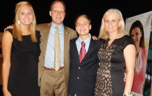 Blue Angel winner Tanja Foil stands next to son, Andy, husband, Franklin, and their teenage daughter.